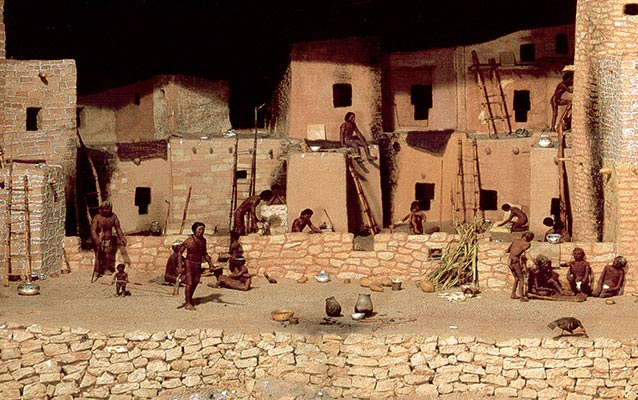 Diorama of Spruce Tree House with Ancestral Pueblo people going about their daily activities