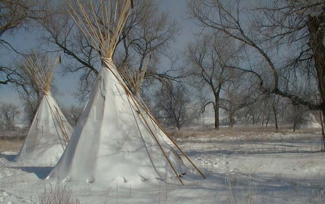 Two tipis in the snow