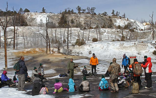A class group listens to a ranger at Mammoth Hot Springs terraces