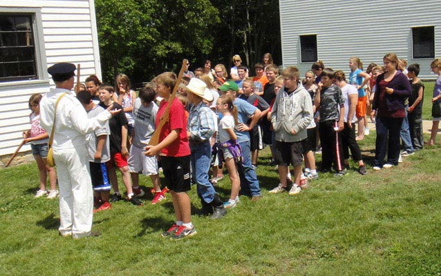 A school group prepares to reenact the Trail of Tears program.