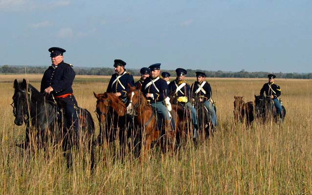 Reenactors portraying dragoon soldiers on the prairie