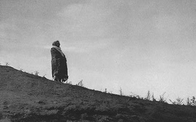 Image of Hidatsa woman on a hilltop.
