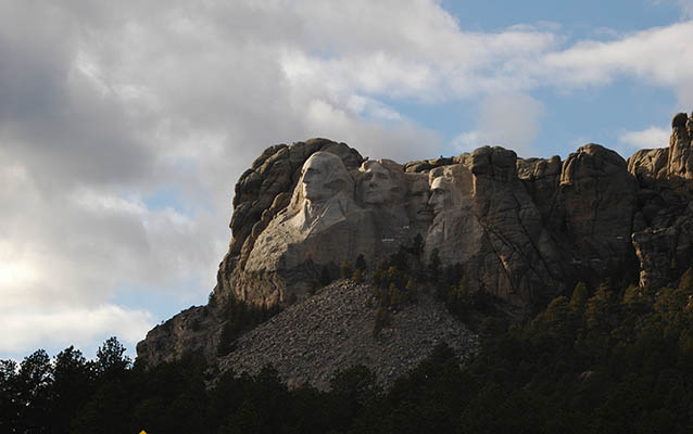 Mount Rushmore under late afternoon sun.