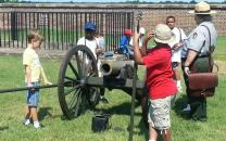 Park Ranger and children with a cannon