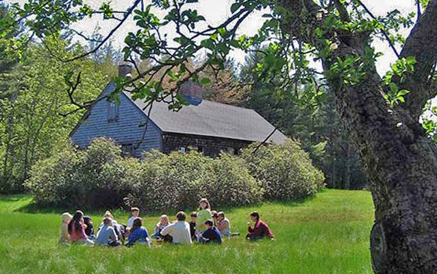 A fourth grade classes uses the Carroll Homestead as an outdoor classroom.