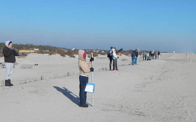 Students setting up beach survey equipment