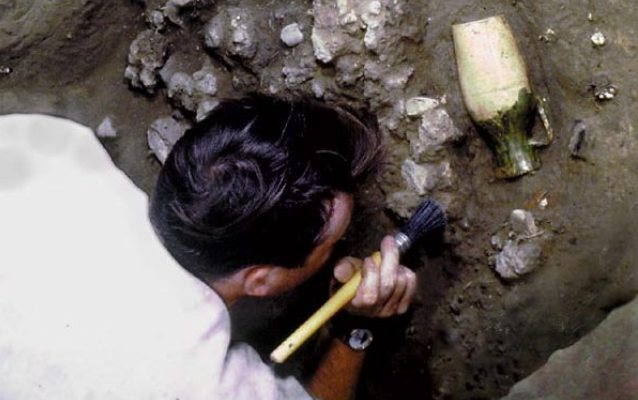An archaeologist excavating a borderware jug