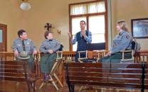 Park rangers with host in the historic Hearing Room during the live Webcast
