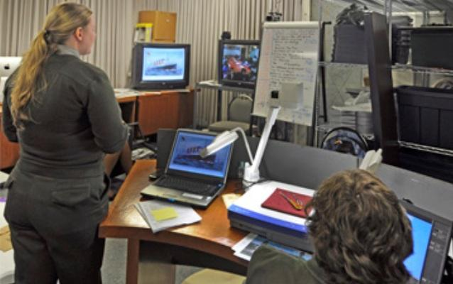 Ellis Island's Distance Learning Studio, one ranger presenting and one ranger teching during a program.
