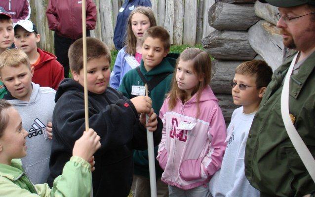 Students loading pretend muskets inside Fort Necessity