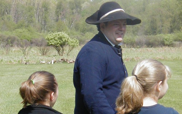 Park Ranger in period costume with students