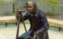 Statue of Albert Gallatin surveying