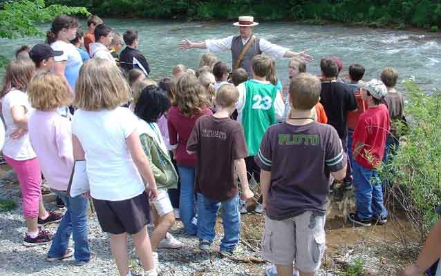 Costumed Ranger leads students on a hike through the break of the South Fork Dam.