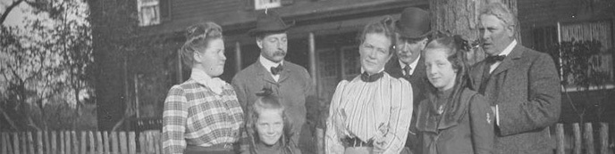 Julian Alden Weir (far right) poses with family in front of the Weir House
