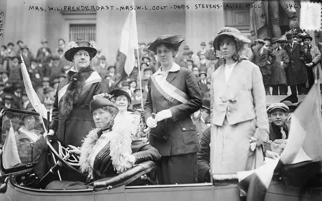 Alice Paul and suffragists in a car during a suffrage parade.  ca. 1910 -15.