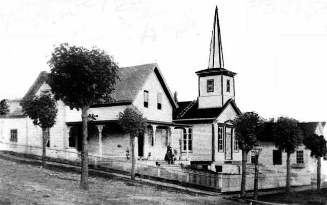 Photograph of Catharine Paine Blaine and the Rev. David E. Blaine's church and parsonage in Seattle, ca. 1854.