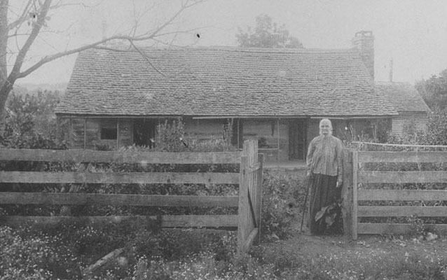 Nancy Morton Staples in front of the Morton Home, c. 1913.