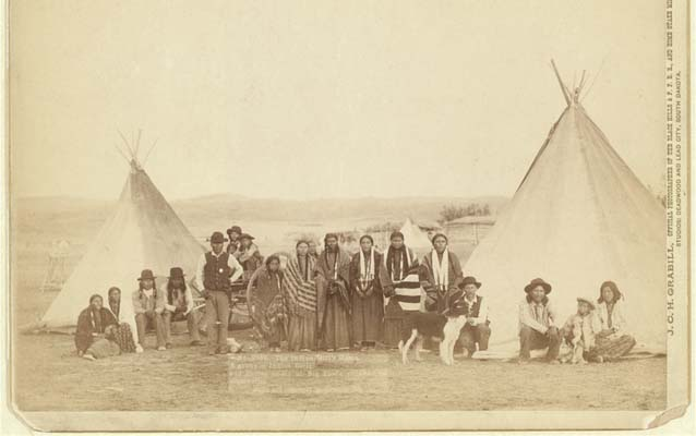 The Indian Girl's Home. A group of Indian girls and Indian police at Big Foot's village on reservation.