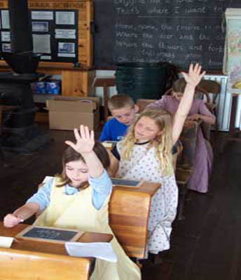 kids attending class in the one room schoolhouse