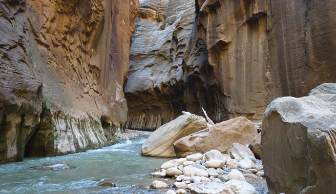 river flowing between narrow canyon walls