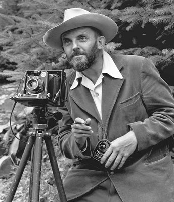 Ansel Adams, who photographed many national parks, operating a camera
