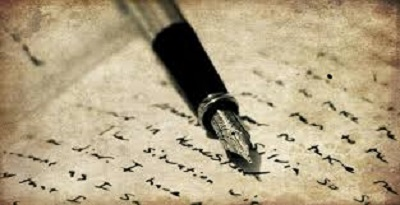 Ink pen lays on top of paper with manuscript writing