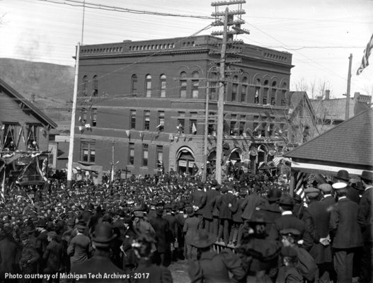 A Spanish-American War militia leaves downtown Houghton