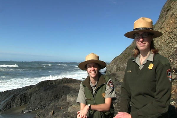 Two rangers on the coast.