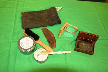 Toiletry Kit with soap, comb, toothbrush, mirror, tooth powder, foot powder