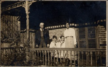 The Pope family outside their home