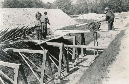 A Civilian Conservation Corps crew installs fraises as part of the reconstruction of fortifications on the Yorktown Battlefield.
