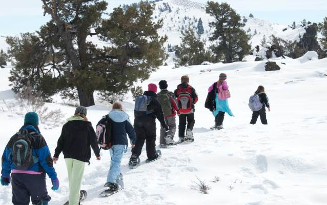 students on snowshoes