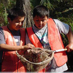Sixth graders getting their hands dirty to better understand the swamp