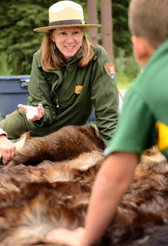 Park ranger shows a moose hide to students.