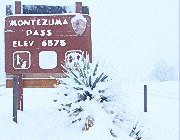 Elevation sign at Montezuma Pass (6575 ft.) in deep snow.