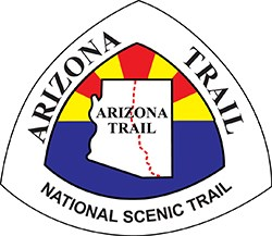 Arizona Trail logo - outline of state of AZ with trail intersection
