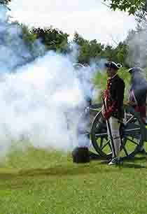 Reenactors fire the cannon at Cowpens National Battlefield.