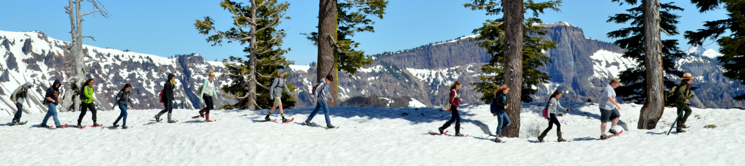 Students follow a ranger along the rim of the Crater Lake caldera on a field trip.