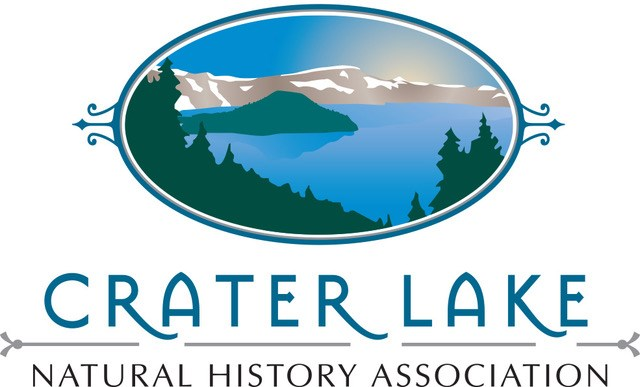 Crater Lake NHA Logo shows an artistic rendering of Crater Lake with Wizard Island, trees, and caldera