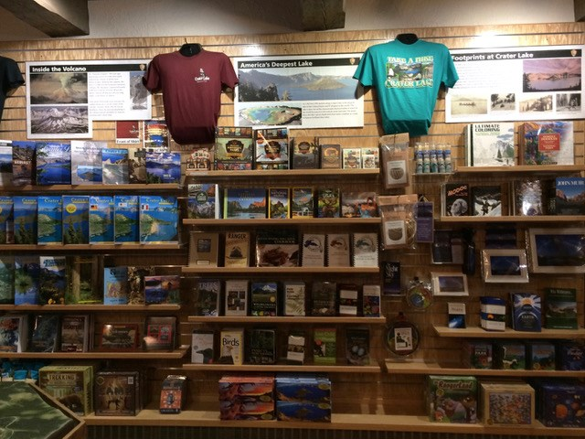 A wall of products in the Crater Lake Natural History Association bookstore