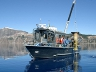 Research Vessel Neuston hoists a sediment trap in Crater Lake.