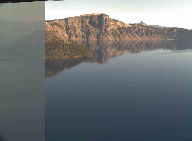 Smoke from wildfires outside the park can obscure the view of Crater Lake during the summer months.