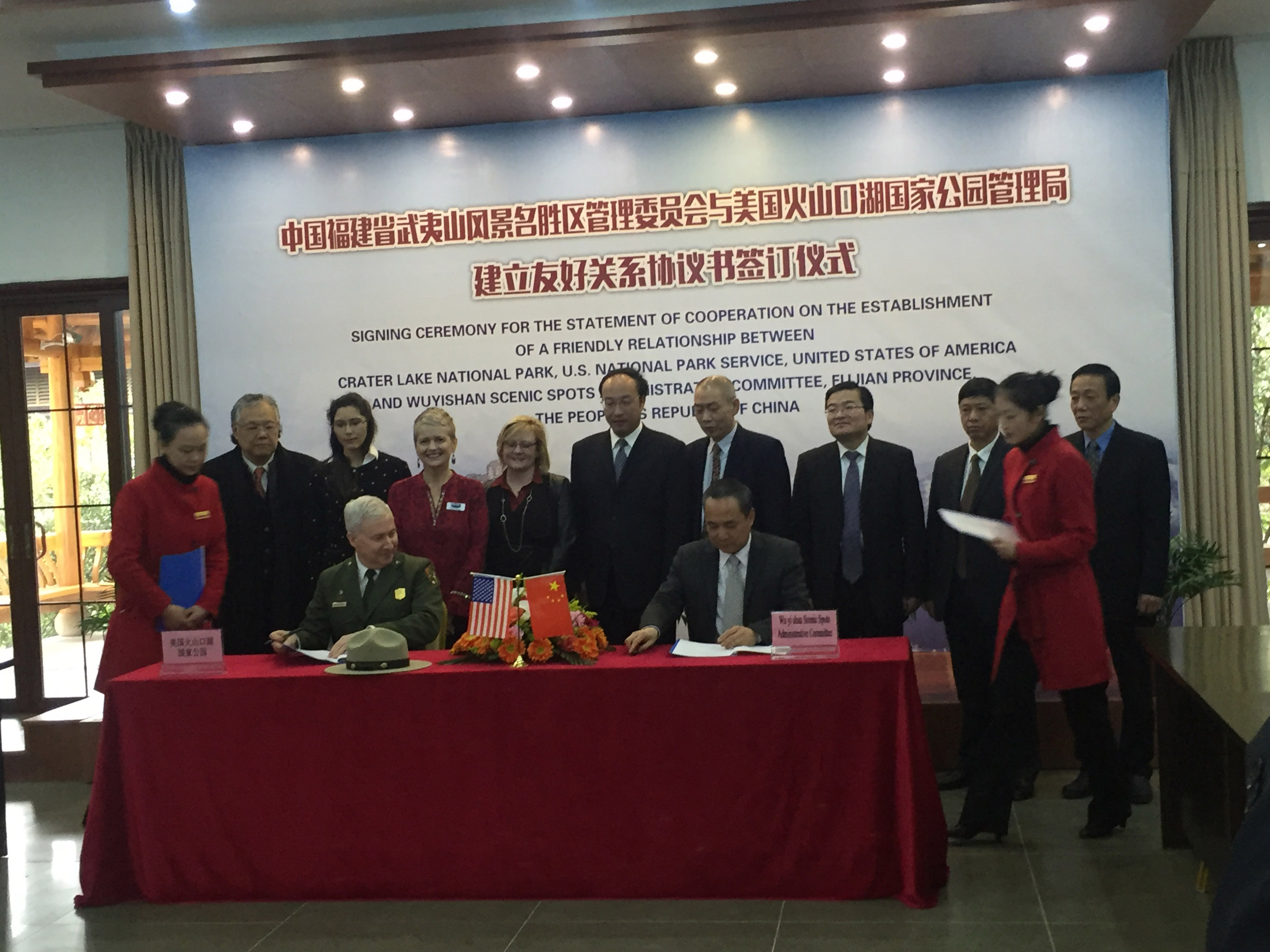 Crater Lake National Park Superintendent Craig Ackerman signs sister park agreement with Wuyishan National Scenic Area in China