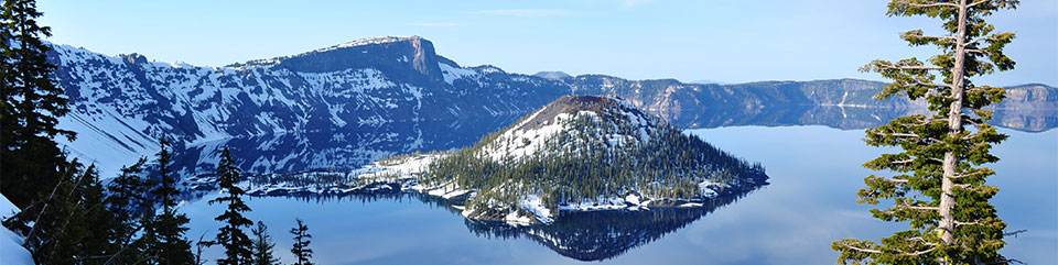 The view from Rim Village of Crater Lake, Wizard Island and Llao Rock.