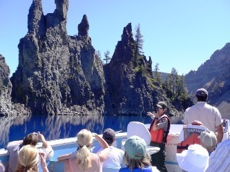Visitors and ranger in a boat on Crater Lake