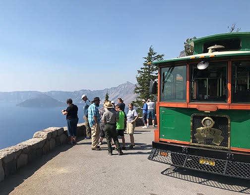 Trolley stopped at an overlook, ranger talking