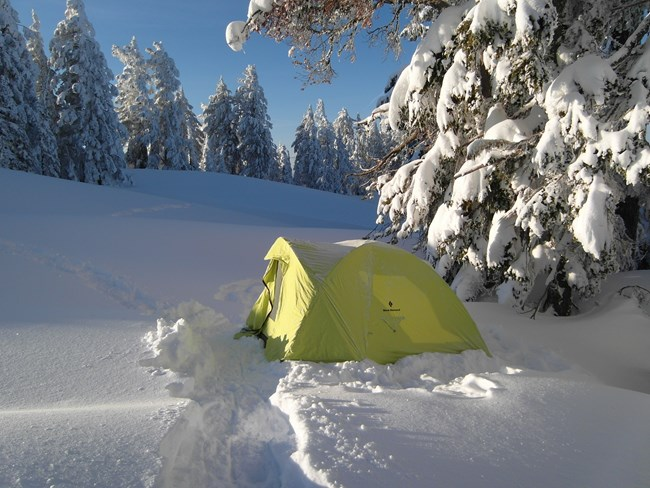 Tent set up on top of deep snow