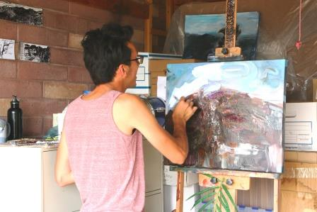 Artist painting the Craters of the Moon landscape