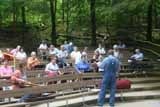 park volunteer teaches visitors about the mountain dulcimer