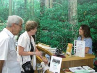 Volunteer welcomes visitors at park visitor center
